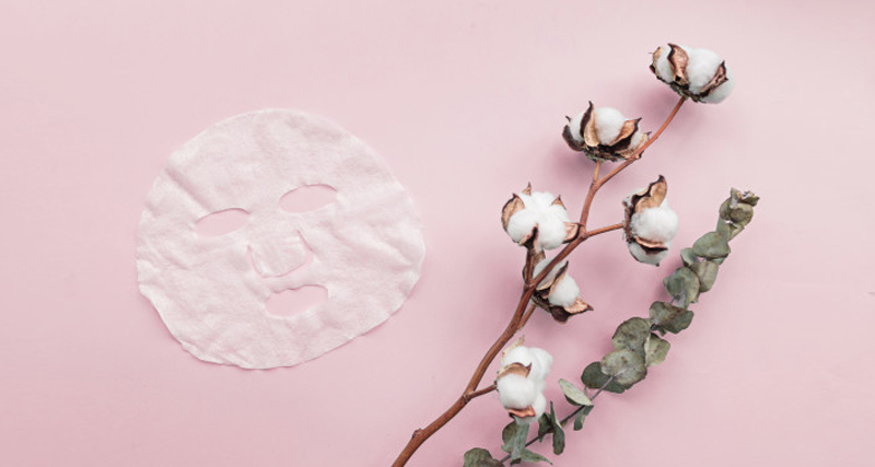 flat lay with sheet facial mask flowers pink background 107592 606